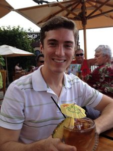 picture of Scott holding a Mai Tai