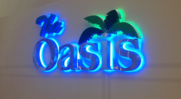 Signage outside the Oasis Lounge