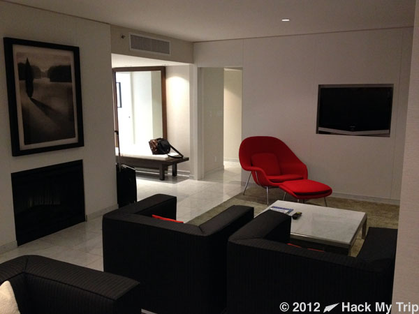 picture of hotel room TV and chairs