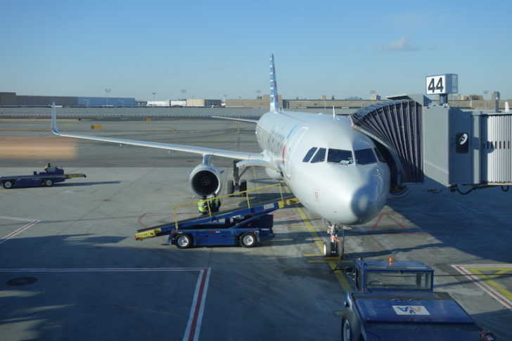 Airbus A321T with jetway at Door 1L